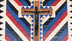 A sculpture of a Black Jesus on a cross in a Christian church in Tanzania, Africa