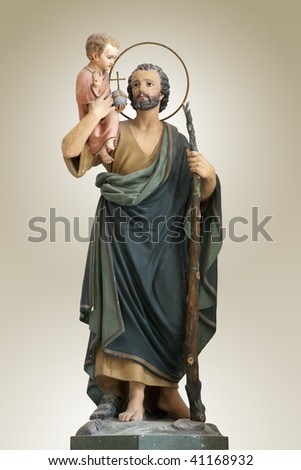 A sculpture of Saint joseph with little jesus christ - Italy