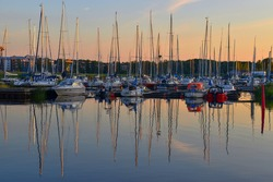 A sea harbour with ships in Nyköping Sweden, sunset, marina, evening, yachts, boats, ships, sport, calm, silent, touristic place, sailor, romantic, destination, summer holidays, north, vessel, sail