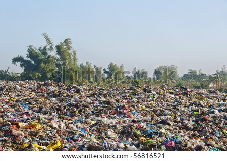 A sea of garbage starts to invade and destroy a beautiful countryside scenery
