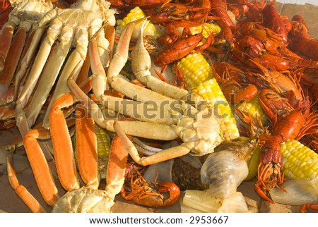 A seafood medley of crab legs, crayfish and vegetables
