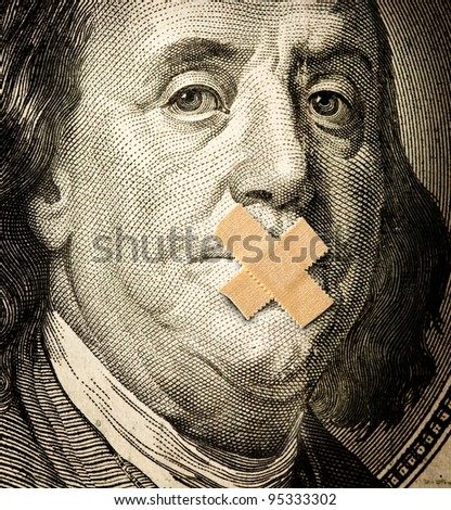 a sealed mouth on the dollar bill, the concept