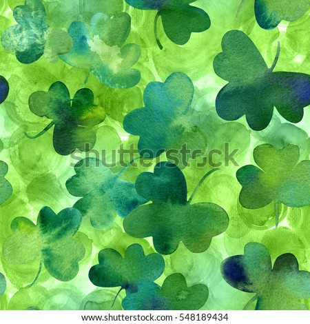 A seamless background pattern with hand drawn watercolour shamrocks on green background