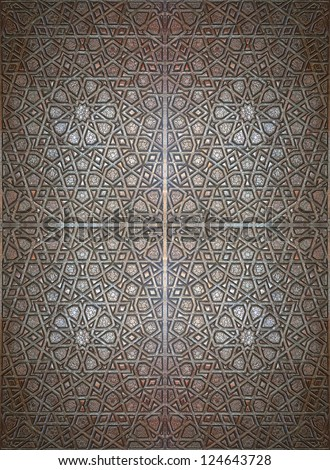 A seamless texture of an islamic design on carved wood
