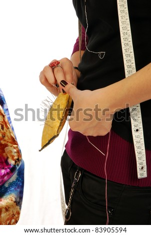 A seamstress  prepares a dress high fashion