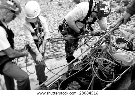 A search and rescue team preforms a high angle rescue as they evacuate an injured climber from a rock pinnacle.