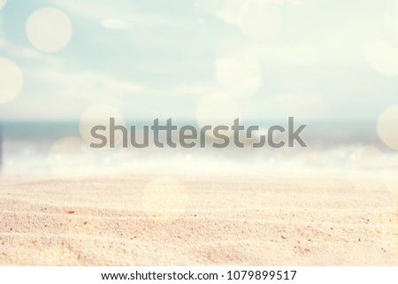 A seascape abstract beach background. blur and bokeh light of lens flare, pastel colors in a vintage and retro style. Focus on foreground