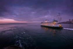 A Seattle to Bainbridge Island Ferry Boat in the early morning hours