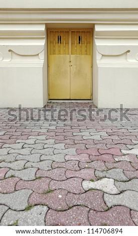 A secret escape door on a vintage ornate mason wall.