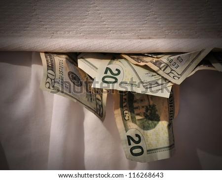 A secret stash of money is hiding under a mattress bed.