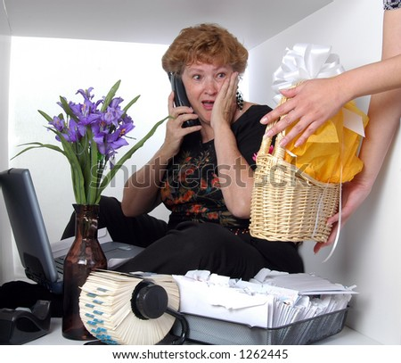 A secretary in a box is presented with a gift