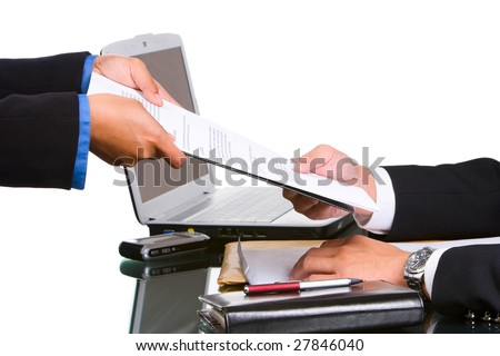 A secretary's hand gives the document to the director.