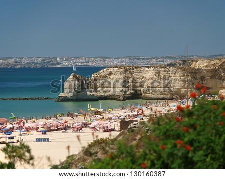 A section of the idyllic Praia de Rocha beach on the Algarve region.