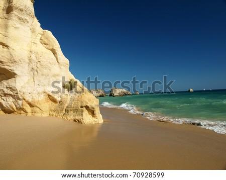 A section of the idyllic Praia de Rocha beach on the southern coast of the Portuguese Algarve region.