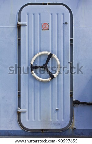 A Security Door on an Aircraft Carrier - stock photo