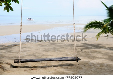 A seesaw hanging on sea beach