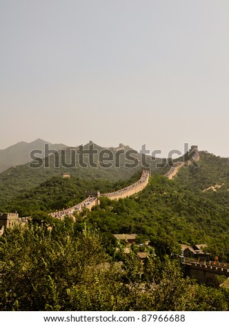 a segment of the great wall of china with tourists in badalin