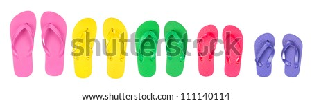 A selection and assortment of rubber flip flops in multiple colors.