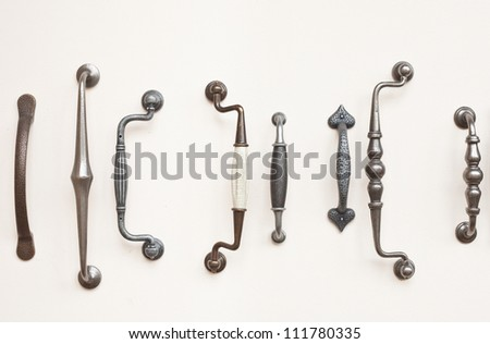 A selection of antique wrought iron door handles