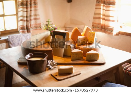 A selection of cheeses on table in Oberstaufen, Allgau, Allgaeu, Bavaria, Germany