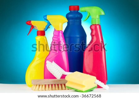 A selection of colorful cleaning equipment on a blue background.