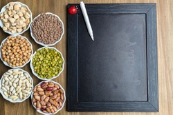A selection of dried pulses legumes and copy space