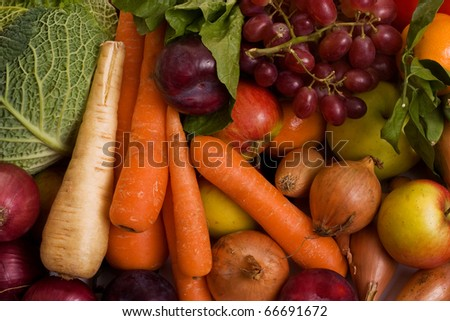 a selection of fresh fruit and vegetables.