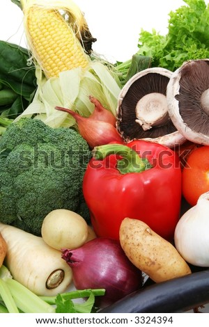 A selection of fresh, healthy vegetables.  Includes sweetcorn, curly lettuce, parsnip, eggplant, onions, potatoes, capsicum, shallots, celery, spinach, tomato, broccoli, and field mushrooms.