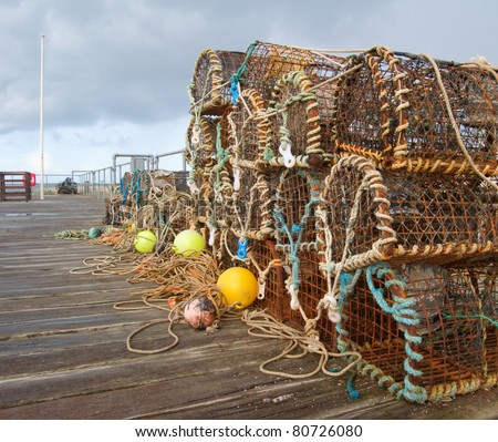 a selection of lobster pots on the boardwalk in Aberdovey, Wales UK