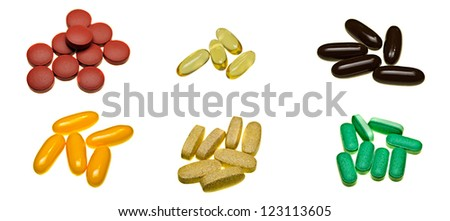 A selection of pill tablets isolated on white