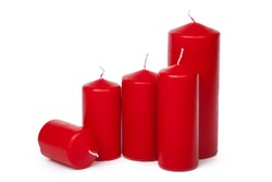 A selection of red candles on a white background