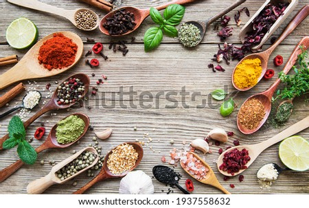 A selection of various colorful spices on a wooden table in  spoons Stock photo ©