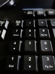 a selective focus of numbers on a computer keyboard