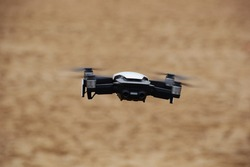 A selective focus shot of a quadcopter in flight