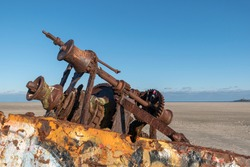 A selective focus shot of a shipwreck on a sandy beach in Norderney, Germany
