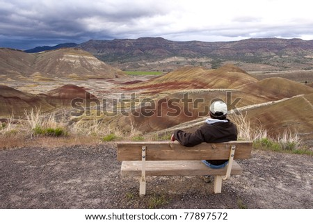 A self portrait of sitting on the bench enjoying the beauty of the Painted Hills in Oregon.