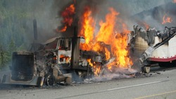 A Semi Truck Burns Out Of Control On The Highway