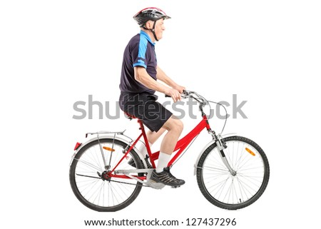 A senior bicyclist ridng a bicycle isolated on white background