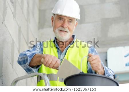 a senior builder with spatula #1525367153
