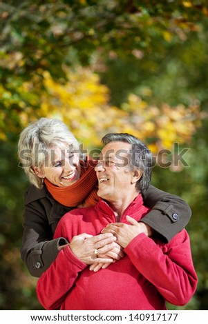 A senior couple enjoying the moment of love in a park