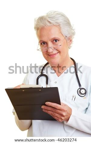 A senior female doctor holding a clipboard