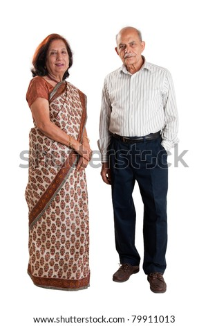 A senior Indian / Asian couple standing - isolated on white