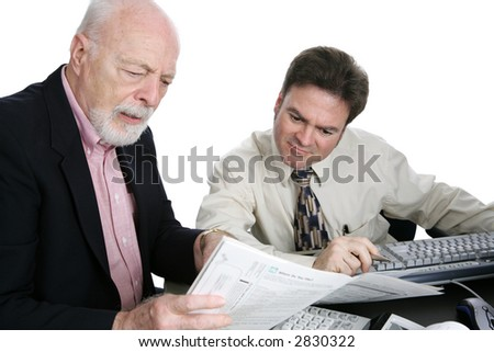 A senior man confused the his tax forms and seeking advice from an accountant.  Isolated on white.