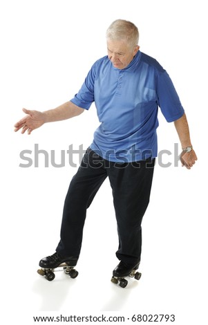 A senior man going into a backwards turn as he waltzes on roller skates.  Isolated on white.