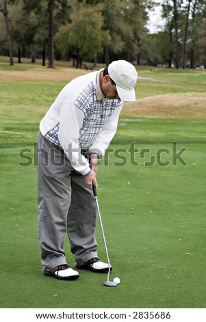 A senior man golfing on a spring vacation in Florida.