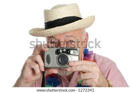 A senior man on vacation snapping photographs.