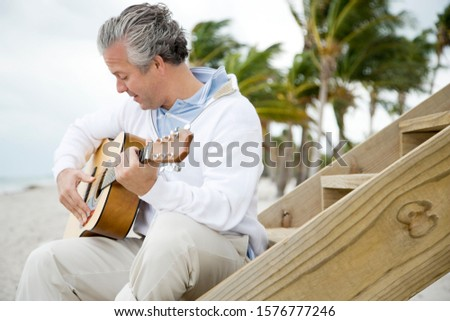 A senior man playing a guitar Stok fotoğraf ©