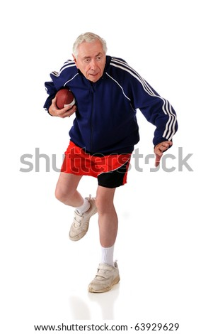 A senior man running with a football.  Isolated on white.