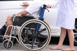 A senior man sitting on a wheelchair