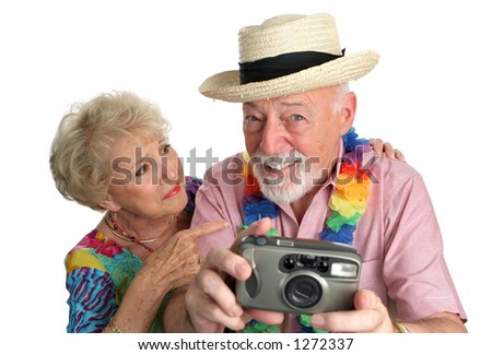 A senior man with a camera taking pictures of pretty girls on the beach while his wife gets mad at him.